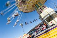 Het spinnen van Carrousel bij de show Stock Foto