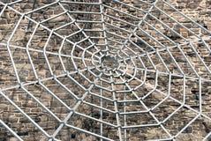 Het spinneweb van het metaal Stock Foto