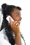 Het spreken aan de ontvanger van de witte telefoon Stock Fotografie