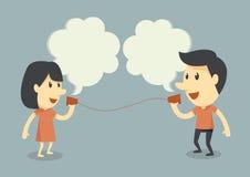 Het spreken met koptelefoon stock afbeelding
