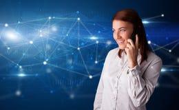 Het spreken op de telefoon met voorzien van een netwerkconcept royalty-vrije stock foto