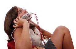 Het spreken op een gekleurde telefoon Royalty-vrije Stock Foto