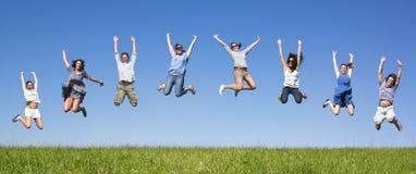 Het springen van de groep Stock Foto's