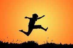 Het springen van de jongen Stock Afbeelding