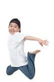 Het springen van de jongen midair stock afbeeldingen