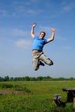 Het springen van de tiener stock afbeelding