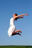 Het springen van de vrouw Stock Foto's