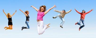 Het springen van het team Stock Afbeelding