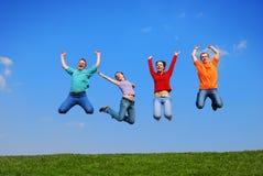 Het springen van mensen Stock Afbeelding
