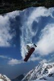 Het springen van Snowboarder stock foto's