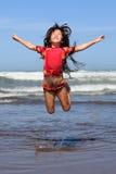 Het springen voor vreugde Stock Foto's
