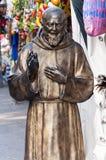Het standbeeld van aalmoezenierpio Stock Foto