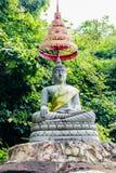 Het Standbeeld van Boedha in Bos Royalty-vrije Stock Afbeeldingen