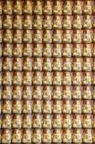 Het standbeeld van Boedha op de muur Stock Afbeelding