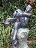 Het Standbeeld van de bronssater Stock Afbeeldingen