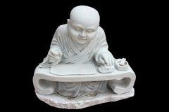 Het standbeeld van de steen van een monnik Stock Foto