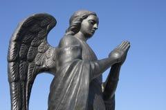 Het standbeeld van het metaal van een engel Stock Afbeelding