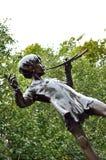 Het standbeeld van Peter Pan Stock Foto