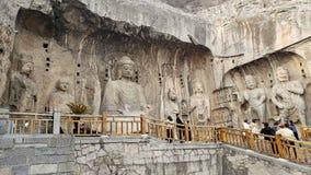 Het standbeeld van steenboedha in Longmen-Grotten, Luoyang stock afbeeldingen