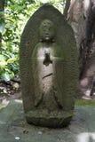 Het standbeeld van Tokyo, Japan - van Boedha in de tuin van het Nezu-museum Stock Fotografie