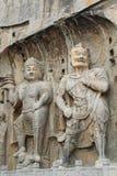 Het standbeeldrots van Boedha het snijden in Longmen-Grotten, Luoyang, China royalty-vrije stock afbeeldingen