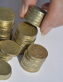 Het stapelen van muntstukken Stock Foto's