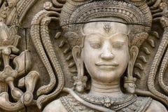 Het steengezicht van de Khmer koning op de muur van Tempel, Stock Fotografie