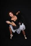 Het stellen van de ballerina over donkere achtergrond Royalty-vrije Stock Foto's