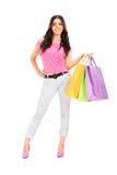 Het stellen van de vrouw met het winkelen zakken Stock Foto