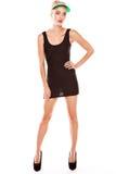 Het stellen van de vrouw in zwarte miniskirt Stock Foto