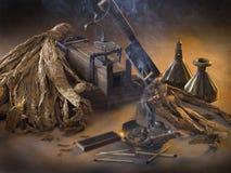 Het stilleven met tabak Stock Foto