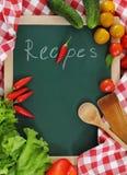 Het stilleven van groenten met receptenspatie stock foto's