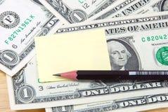 Het stootkussen en het potlood van de geldnota Stock Fotografie