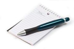 Het stootkussen en het potlood van het memorandum Stock Foto