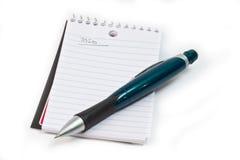 Het stootkussen en het potlood van het memorandum Stock Foto's