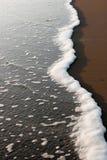 Het Strand van de zonsondergang Stock Afbeelding