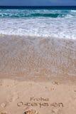 Het strand van het zand in de zomer Stock Foto