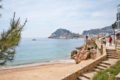 Het strand van Tossa de Mar, Costa Brava Stock Foto's