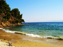 Het strand zonnige dag van de zomer Stock Afbeeldingen
