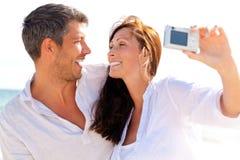 Het strandpaar van de foto Stock Foto's