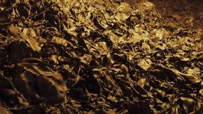 Het stromen onderaan abstracte massa in geel stock footage