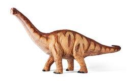 Het stuk speelgoed van Apatosaurusdinosaurussen met het knippen van weg wordt geïsoleerd die Stock Afbeelding