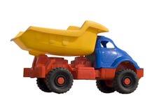 Het stuk speelgoed van de baby stortplaatsvrachtwagen die op wit wordt geïsoleerdn Stock Fotografie
