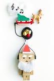 Het stuk speelgoed van de Kerstman en de muziekwolk Royalty-vrije Stock Foto