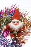 Het stuk speelgoed van de Kerstman in kleurrijke grenzen royalty-vrije stock foto's