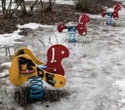 Het stuk speelgoed van de kinderen` s speelplaats in graffiti wordt behandeld die royalty-vrije stock afbeelding