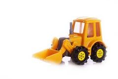 Het stuk speelgoed van de tractor Stock Foto