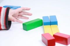 Het stuk speelgoed van het de handenspel van het kind Royalty-vrije Stock Afbeeldingen