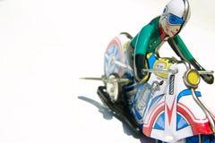 Het stuk speelgoed van het tin uitstekende motorfiets Stock Foto's