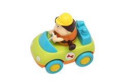 Het stuk speelgoed van kinderen auto met bestuurder. stock afbeelding